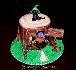 halloween witch falls on tree cake with cat topper