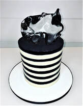 black and white buttercream stripped cake